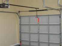 Garage doors and openers should be handled safely.
